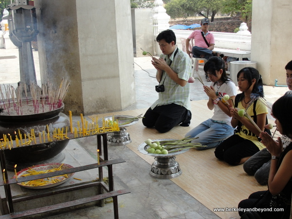 worshippers at Wat Phra Sri Sanphet at Ayutthaya Historical Park in Thailand