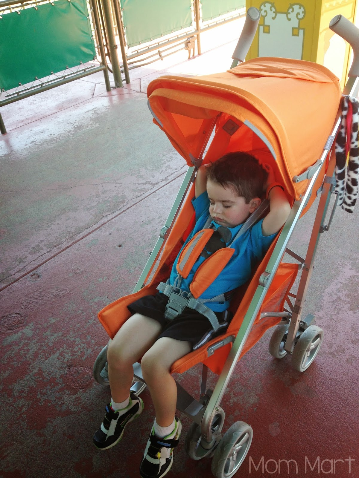 Strollers at Disney World #Disney #Strollers #TipsAndTricks waiting in the stroller for Disney Transportation {boat ride}