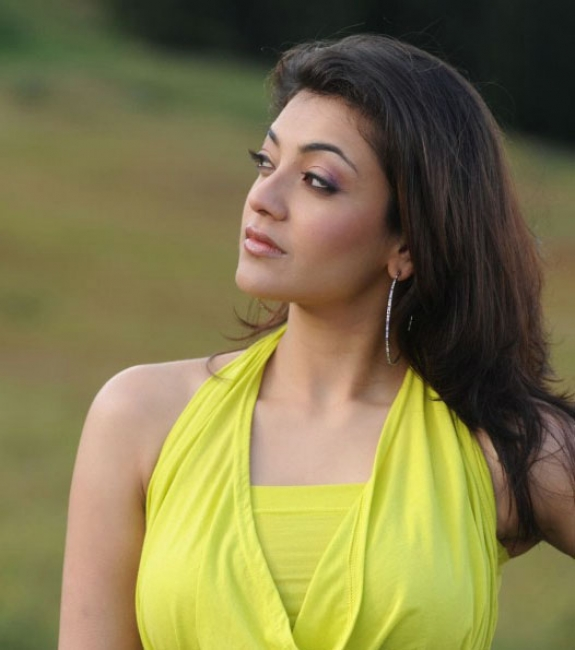 Spicy Kajal Agarwal In Hot Mood Yellow Dress Latest Stills Photos hot images