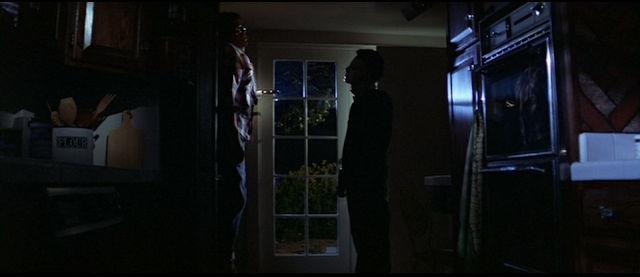 Michael Myers pins Bob to the door in HALLOWEEN (1978)