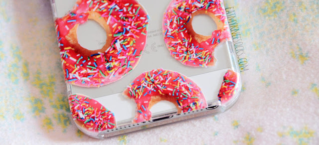 Close-up on the detailed donut print on the realistic clear iPhone 5 case from Clash Cases on Etsy.