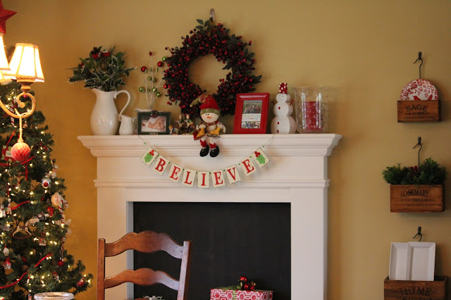 faux fireplace at Christmas with hanging herb crates www.goldenboysandme.com