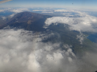 Mauna Loa peaking through the clouds