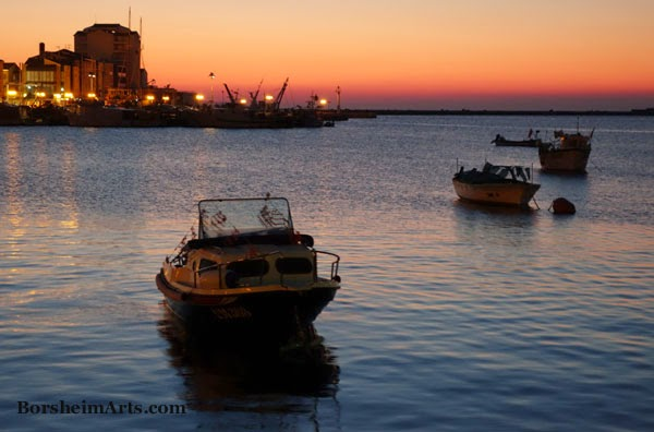 sunset over harbor in Umag, Croatia