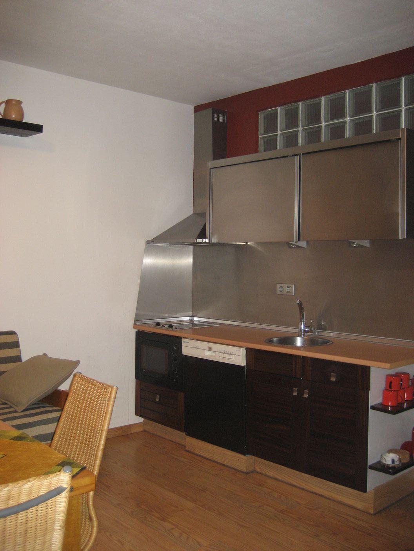 La plancha de acero inoxidable de la cocina de merce - Plancha de cocina ...