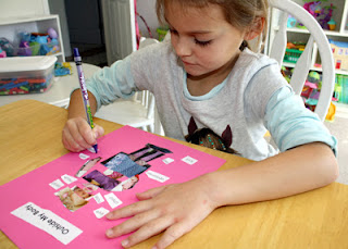 Tessa cut out body parts from various pictures in catalogs and magazines. She glued the pieces onto card stock to create a collage person and then labeled the parts.