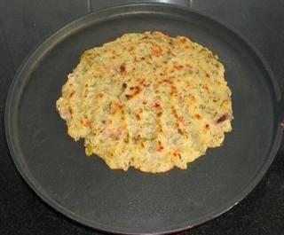 shallow fry the rava uttapa till golden brown