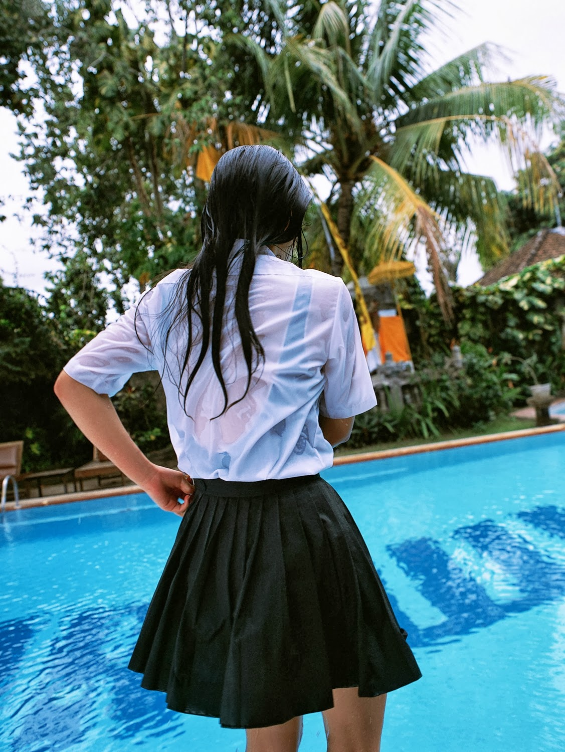 school girl in wet uniform