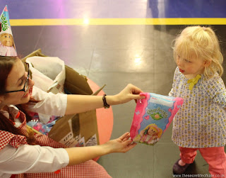 Toddler being given a party bag