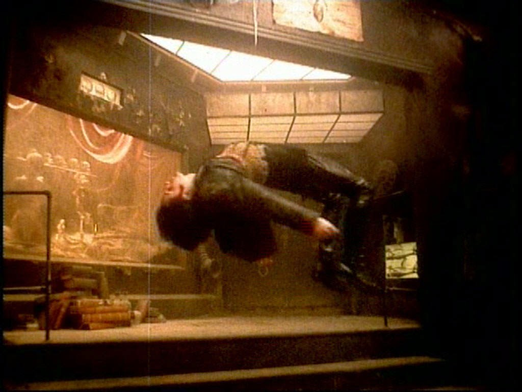 Picture of man hanging from music video of Song Closer by the band Nine Inch Nails