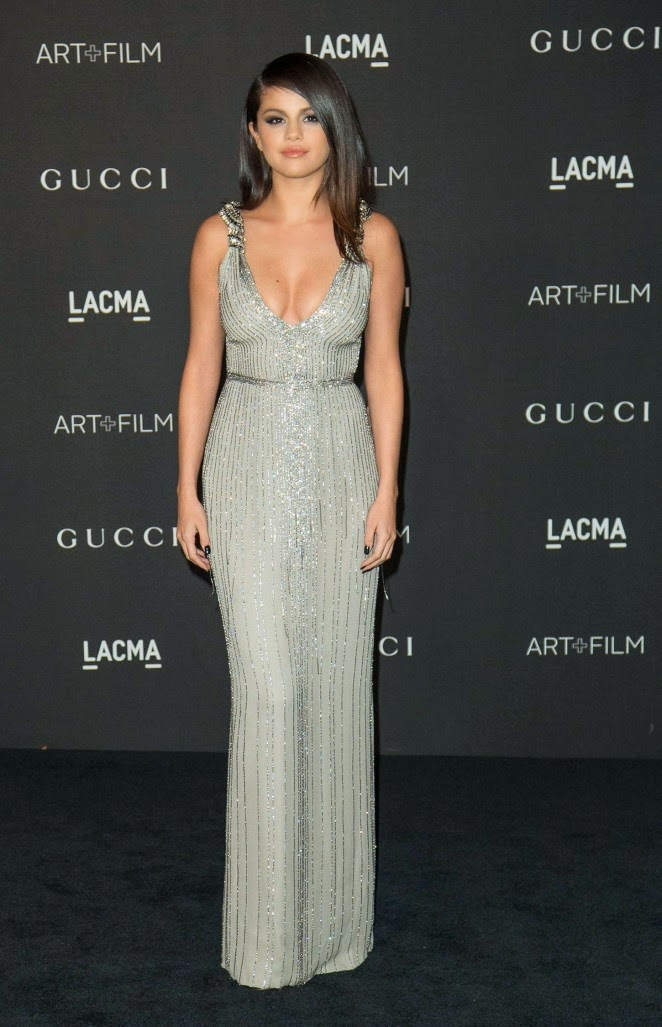Selena Gomez displays cleavage in a plunging silver gown at the 2014 LACMA Art + Film Gala