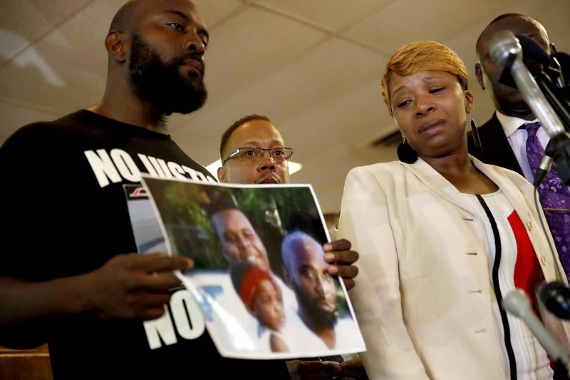 Michael Brown's family. Photo via http://www.nbcnews.com/storyline/michael-brown-shooting/michael-brown-family-lawyer-process-broken-n255766