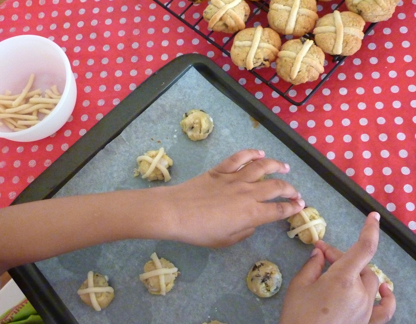 Placing marzipan crosses on the Hot Cross Bun Cookies