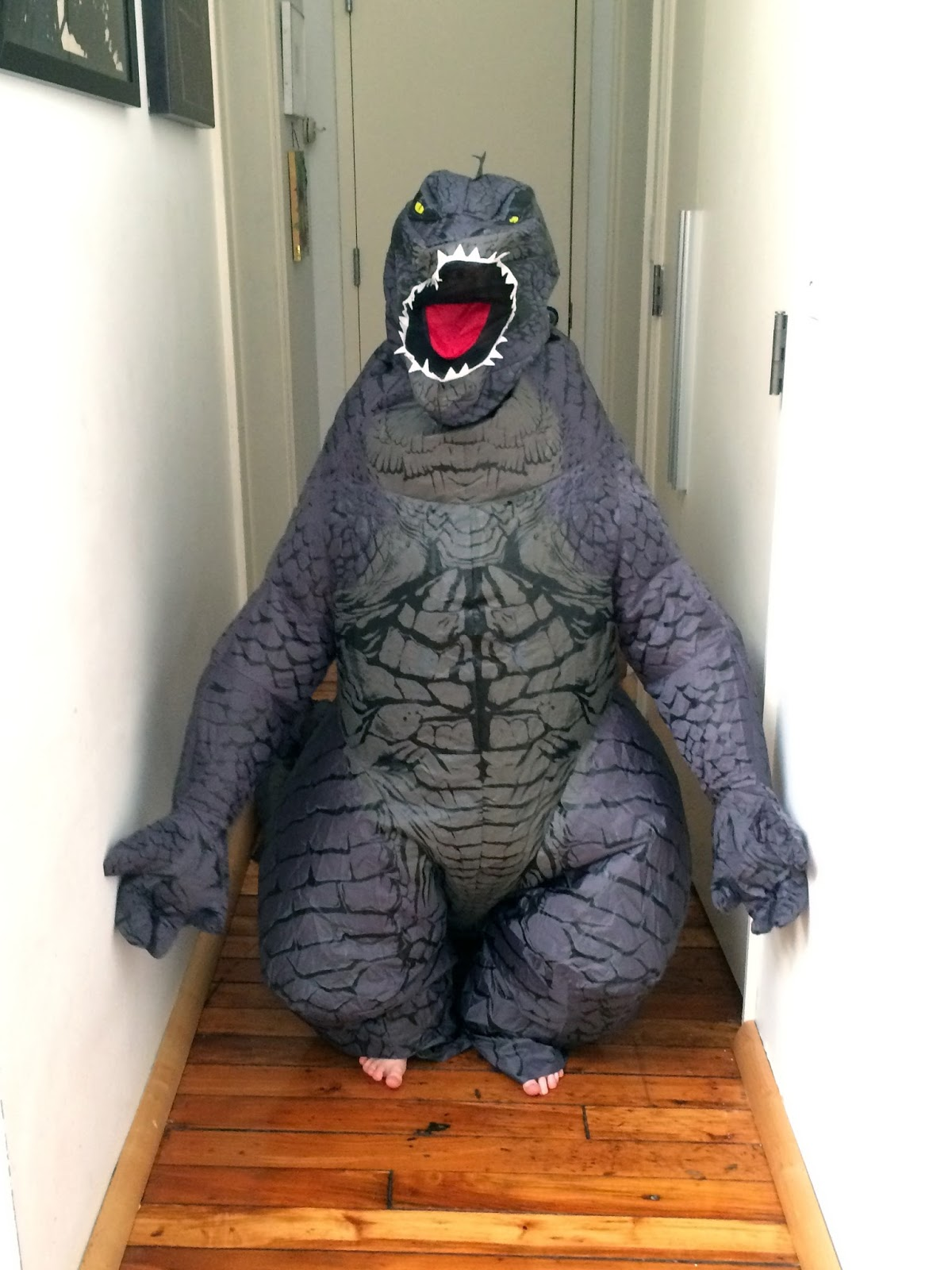 to width ratio is even more un godzilla like but i am so amused by the tiny human toes peaking out of the feet that i could not resist including it