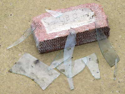 A brick and broken glass