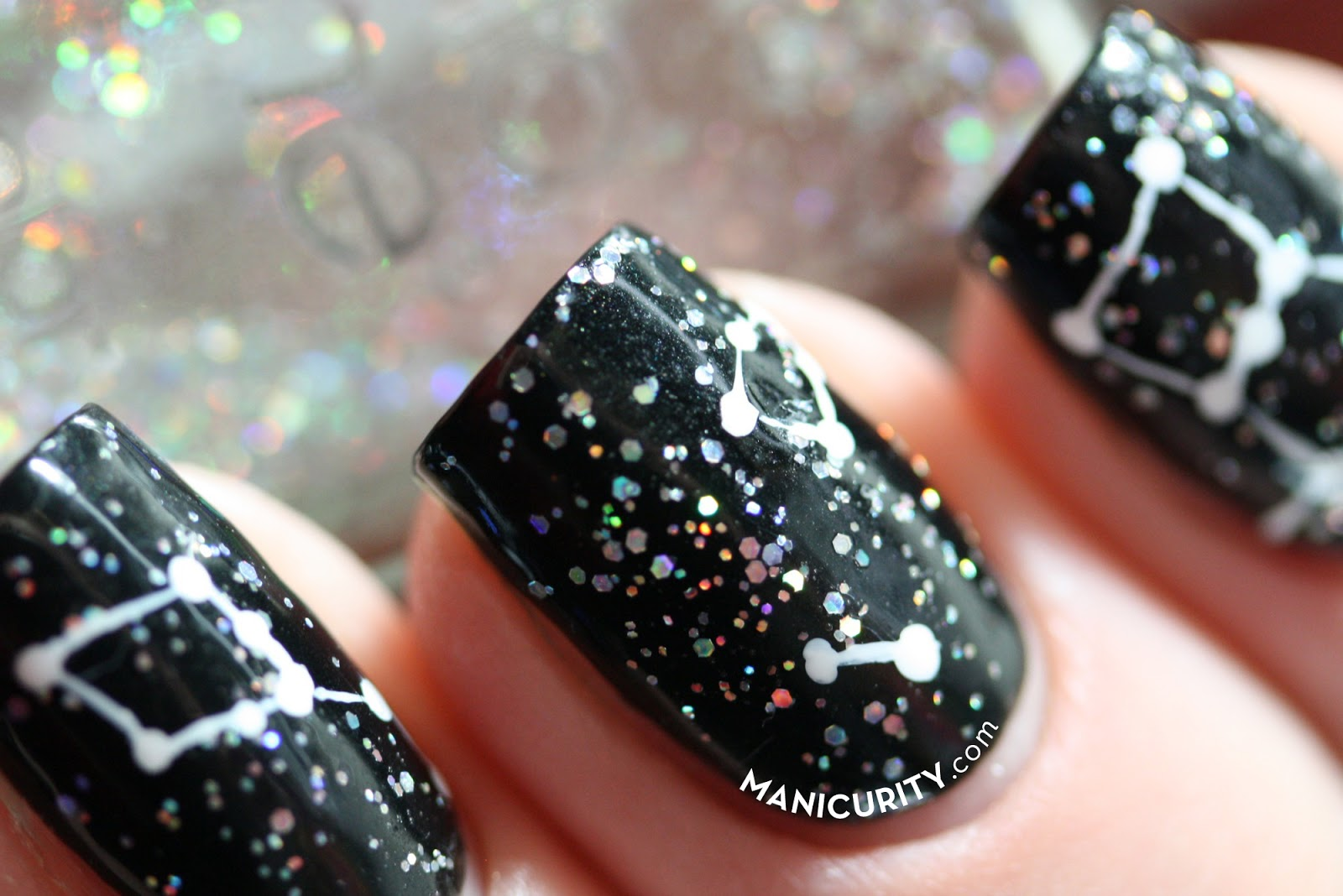 Manicurity.com | Constellation Nails! Super easy black and white nail art idea