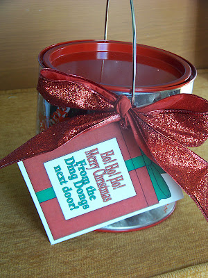 Give your neighbors a quick and cheap neighbor gift this Christmas.  This simple Christmas gift is filled with Ho Hos and Ding Dongs to bring a smile to your neighbors lips and a little more fun all year round.