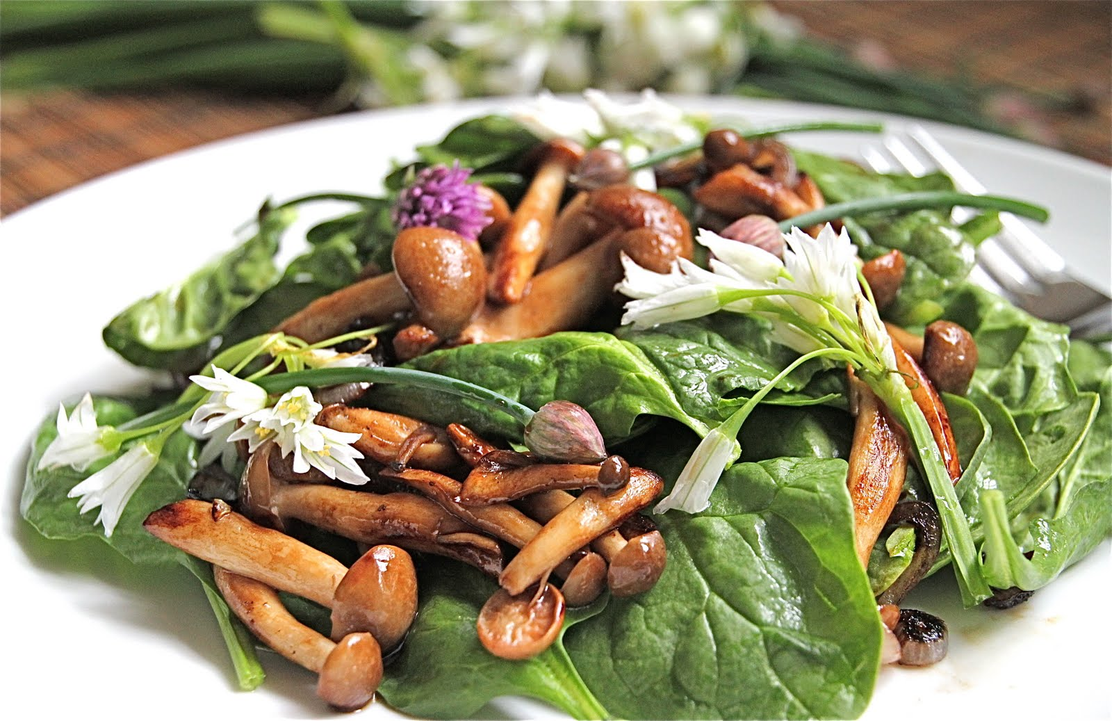 Warm Mushroom Spinach Salad with Fresh Arugula Flower and Chives