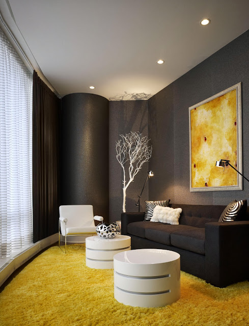 cool black accent wall and sofa to contrast beautifully with yellow rugs and white furniture and accessories