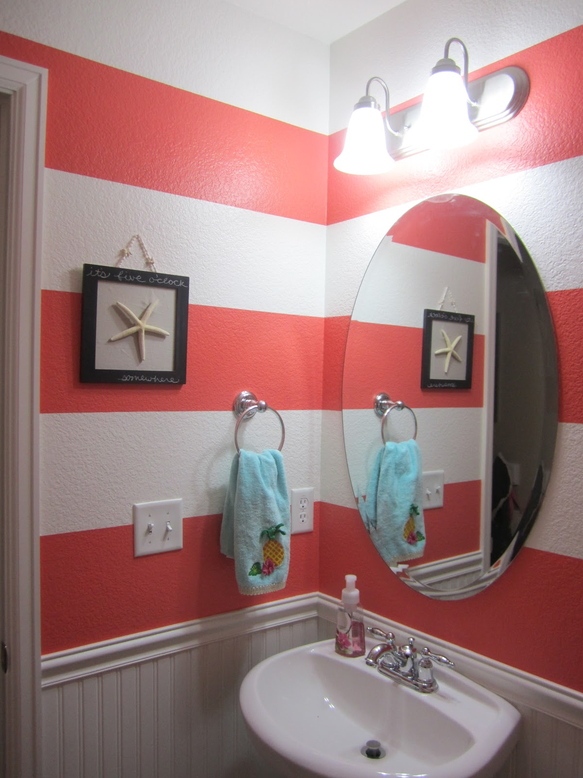 Just another day in paradise coral striped bathroom