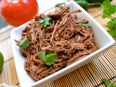 20 Delicious Recipes for Slow Cooker Beef Tacos from Food Bloggers featured on SlowCookerFromScratch.com