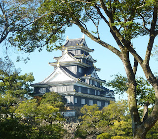 Okayama Castle through trees as seen from the Korakuen Garden, Okayama