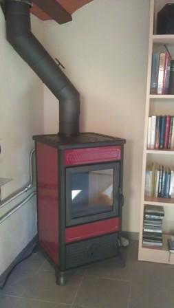 Biomasa calentar toda una mas a con una estufa de le a - Instalacion estufa lena ...