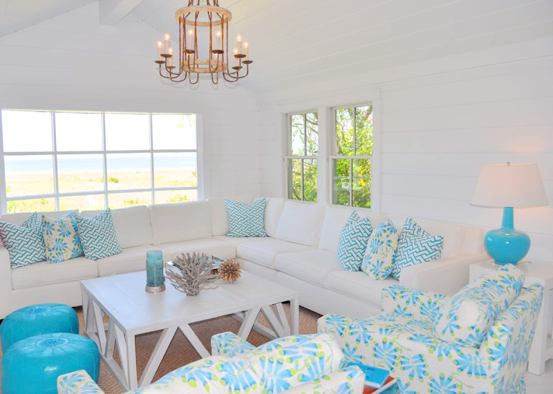 This bright Nantucket beach cottage was designed by Lynn Morgan . It  title=