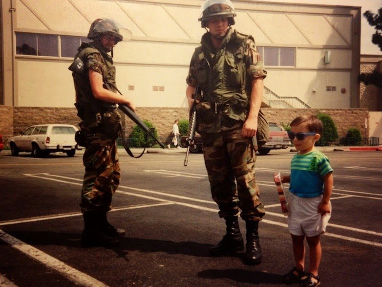 35 moments of violence that brought out incredible human compassion - a child poses beside national guard members during the la riots