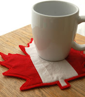 http://www.patchworkposse.com/easy-maple-leaf-mug-rug/