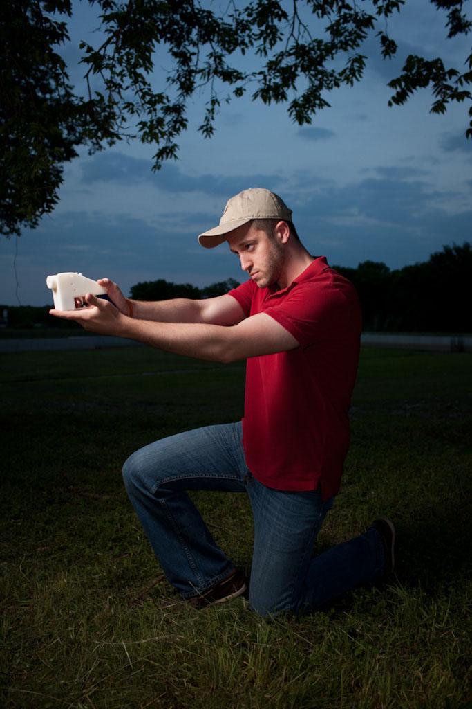 cody wilson holding a gun