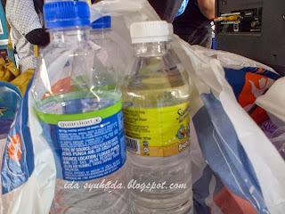 Perbezaan Air Botol Penutup Biru Dan Putih