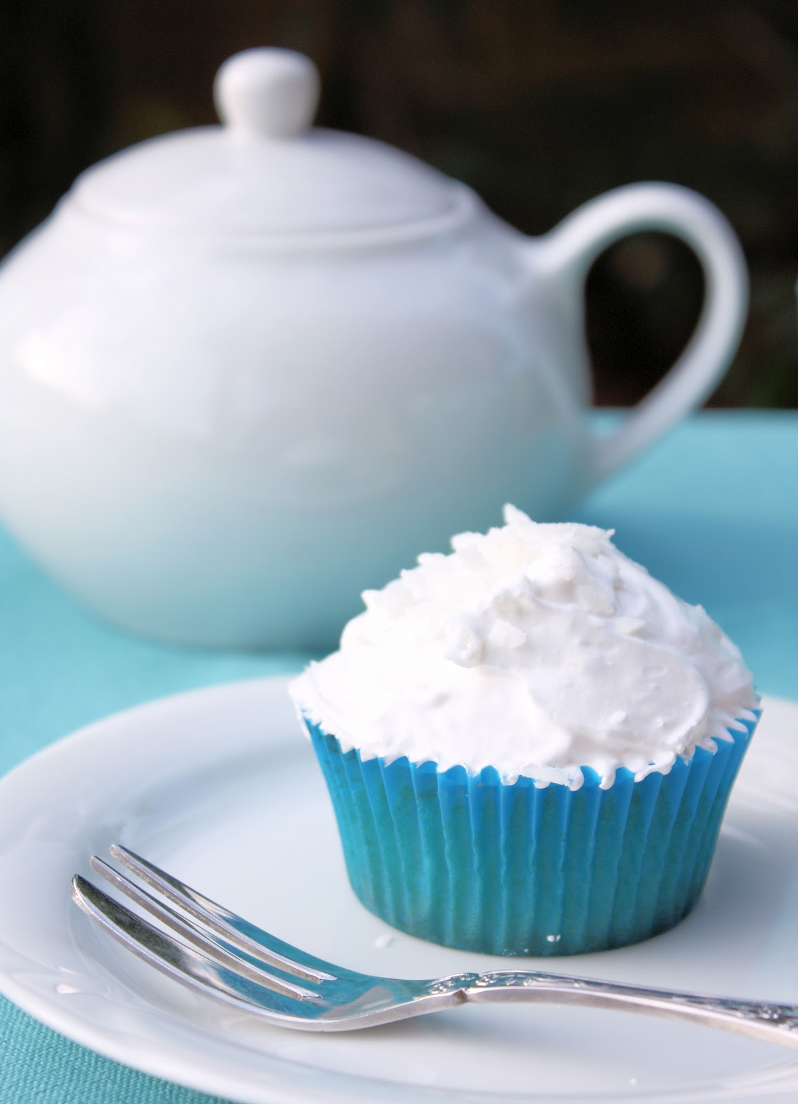cupcake is deliciously moist and includes shredded coconut, coconut ...