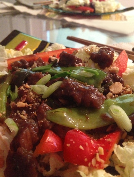 Image of Slow-cooker Mongolian Beef Salad on a plate with chop sticks