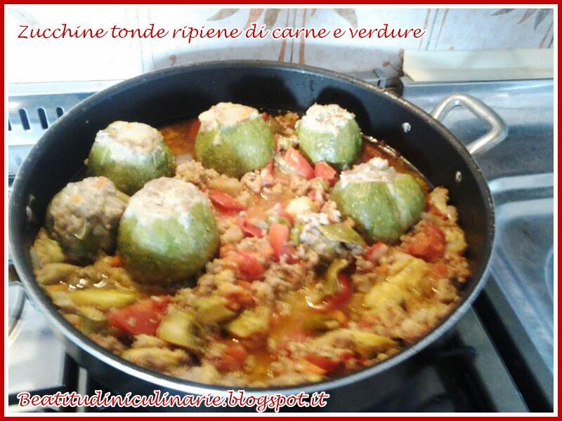zucchine tonde ripiene di carne e verdure al sugo