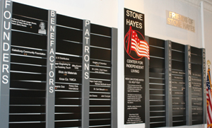 A donor list is displayed on the wall in the Stone-Hayes office