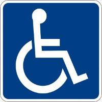 Handikappsskylten med schabloniserad person med utsträckta armar i rullstol
