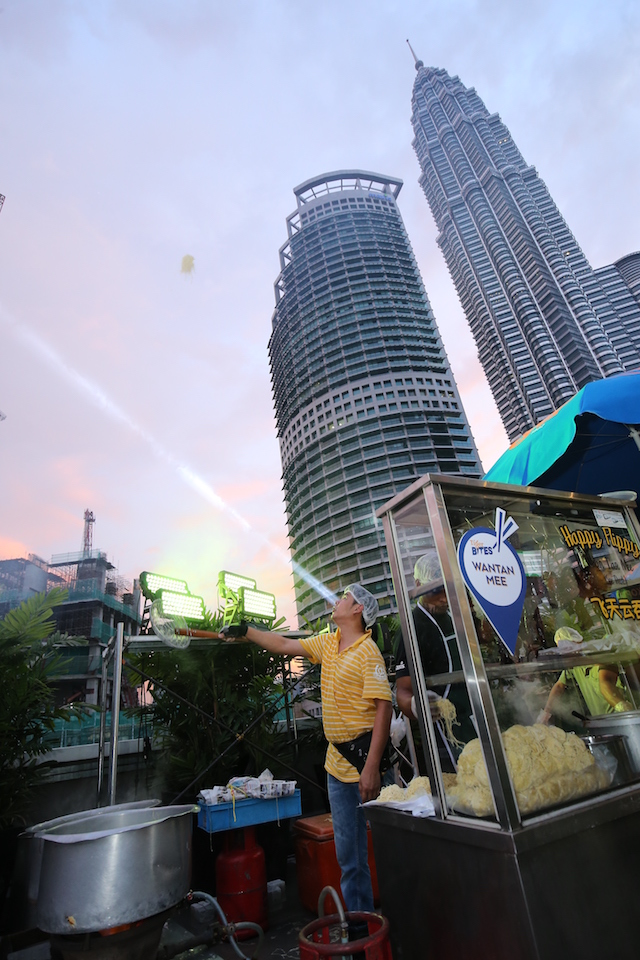 Have you seen noodles tossed two stories high with the Petronas Twin Towers in the background