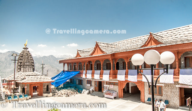 Recently some of us were on Kinnaur Trip and there is place called Jeory on the way. Sarahan is approximately 30 kilometers from Jeory and it's a beautiful town located on hill-top with amazing views of snow covered hills of Kinnaur. Bheemakali temple of Sarahan is most popular place to visit and this Photo Journey shares some of the moments spent around Bheema Kali Temple.Bheema Kali Temple has a huge campus and different temples inside the campus. There are two main temples, out of which one is accessible to everyone during normal days.The Second one is opened on some special occasions and Devi only allows Raja Virbhadra Singh to open the door of that temple. Shri Bheema Kali Temple is located in Sarahan town of Himachal Pradesh in India which is dedicated to the mother goddess Bhimakali, presiding deity of the rulers of former Bushahr State. The temple is situated about 180 km from Shimla and is one of 51 Shakti Peethass. The temple complex has another three temples dedicated to Lord Raghunathji, Narsinghji and Patal Bhairva Ji (Lankra Veer) - the guardian deity.Architecture of Bheema Kali Temple is beautiful. Whole campus is built with Stone and wooden blocks. It seems some part of the campus has not even cement to fix the joints. Whole campus is very well maintained and there is enough security as well.Here is one of the doors of the Bheem Kali temple in Sarahan Town. It's made up of silver with beautiful carving. There is also some text written, mostly in Hindi and Tibbatian scripts. Most of the carved forms are different gods and linked through some old stories.Sarahan was the capital of rulers of former Bushahr State. Bushahr dynasty earlier used to control the state from Kamroo. The capital of state later was shifted to Sonitpur. Later Raja Ram Singh made Rampur as the capital. It is believed that the country of Kinnaur was the Kailash mentioned in Puranas, the abode of Shiva. With its capital at Sonitpur this former princely state was extended up to entire area of Kinnaur where for sometimes Lord Shiva disguised himself as Kirata. Today, the then Sonitpur is known as Sarahan. Banasura, the ardent devotee of Lord Siva, eldest among the one hundred sons of great ablative demon King Bali and the great grandson of Vishnu votary Prahlad, during the Puranic age was the ruler of this princely state.(Courtesy - http://en.wikipedia.org/wiki/Bhimakali_Temple)According to a legend, the manifestation of the goddess is reported to the Daksha-Yajna incident when the ear of the Sati fell at this place and became a place of worship as a Pitha - Sthan. Presently in the form of a virgin the icon of this eternal goddess is consecrated at the top storey of the new building. Below that storey the goddess as Parvati, the daughter of Himalaya is enshrined as a divine consort of Lord SivaThere is a small market around Bheema Kali Temple and there are enough shops to have lunch or light snacks. Apart from that local caps can be bought from this fellow. He was very welcoming and offered good discounts for us :). We had asked for rates in Rampur Market, but he had better stuff and reasonable prices. There are many other shops in the town where some local stuff can be procured. On top of all that, most of the folks were really sweet to interact with.During our visit, we were looking for ladies wearing Dhaatu but couldn't gain the courage to ask anyone to get clicked by us. And just outside the Bheema Kali temple, this lady asked us to click one of her photograph and show her how we click. Probably she was noticing us clicking & reviewing photographs around the temple. We clicked few shots and showed to her. She shared some tips to improve and finally approved few of the shots. After final approval, she invited us to her hotel nearby but we couldn't go because it was time to head back as we had booked guest-house in Jeory.Here is a nearby sight, which is popularly known as Hawa-Ghar. This point has very clear view of Kinnar-Kailash Hills and place was quite windy. We spent around 30 minutes here to enjoy the breeze and take rest. This place is isolated form hustle bustle of the town. When we reached, there was only one person sitting here. Probably this place was least used by localites, as everyone has Hawa-ghar around their own houses :)Whole place was surrounded by Pine or Deodar Forests and smell was awesome in the middle of these forests. It was really an amazing experience to roam around Bheema Kali Temple and Sarahan Town. Meeting different people, visiting one of the amazing temples in this region, Hawa Ghar, a huge house of old kingdom etc.The town Sarahan is known as the gateway of Kinnaur. Down below at a distance of 7 km from Sarahan is the River Satluj. Sarahan is identified with the then Sonitpur mentioned in Puranas.Before entering into the main temple, everyone needs to lock mobiles, wallets or anything else which is made of leather and then wear a cap. Above photograph shows Aneesh wearing the holy cap and standing on right side of lockers everyone gets to keep everything safe.