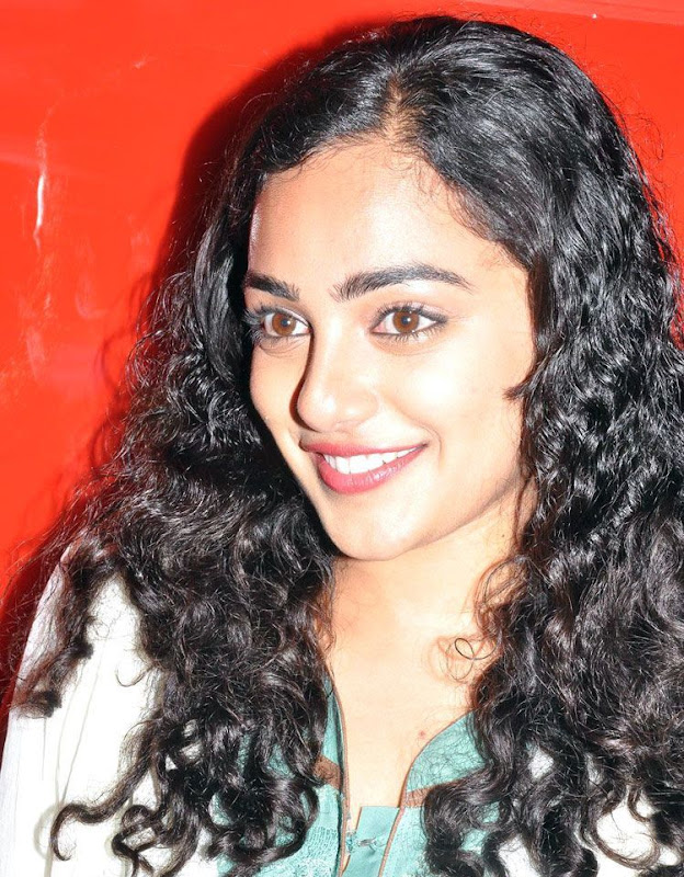 Nithaya menon Cute Stills in  tamil Movie Press meet new Photos Photoshoot images