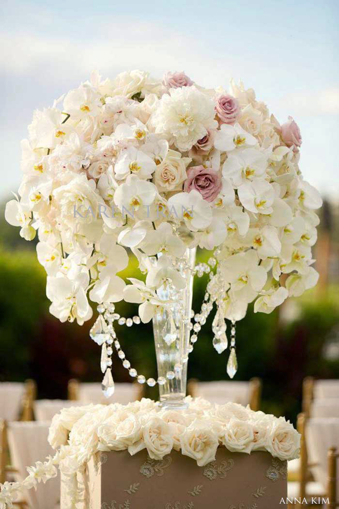 Wedding ceremony flowers belle the magazine for Floral arrangements for wedding reception centerpieces