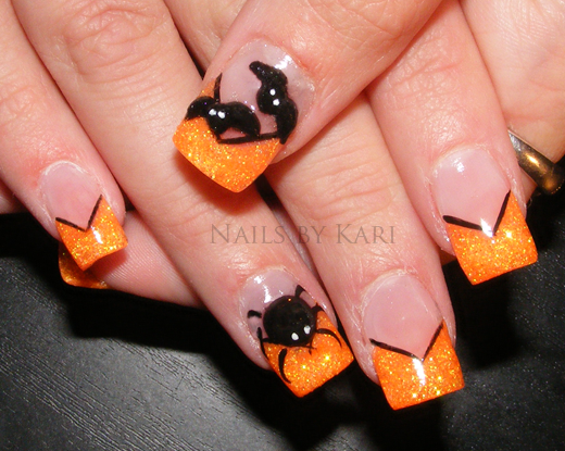 Orange and Black Nail Designs http://naildesigniwik.blogspot.com/2011/07/orange-nail-design-ideas.html