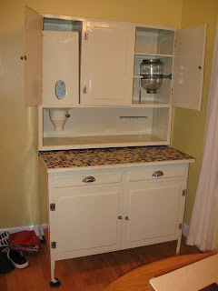 has finished stripping and refinishing the hoosier cabinet for me