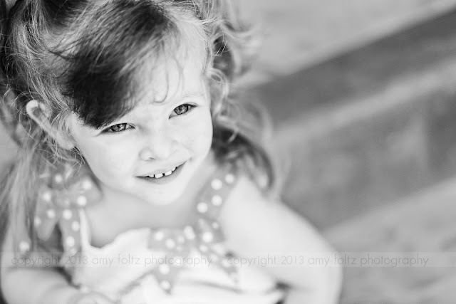 black and white photo of a little girl smiling