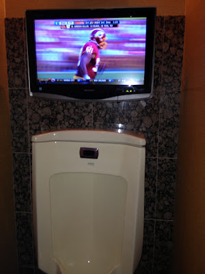 Daniel Snyder's owner's box men's bathroom urinal