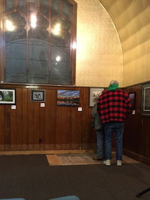 photographs hung in the alcove