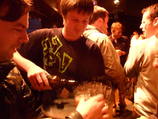 Chris Williams pours samples of beer