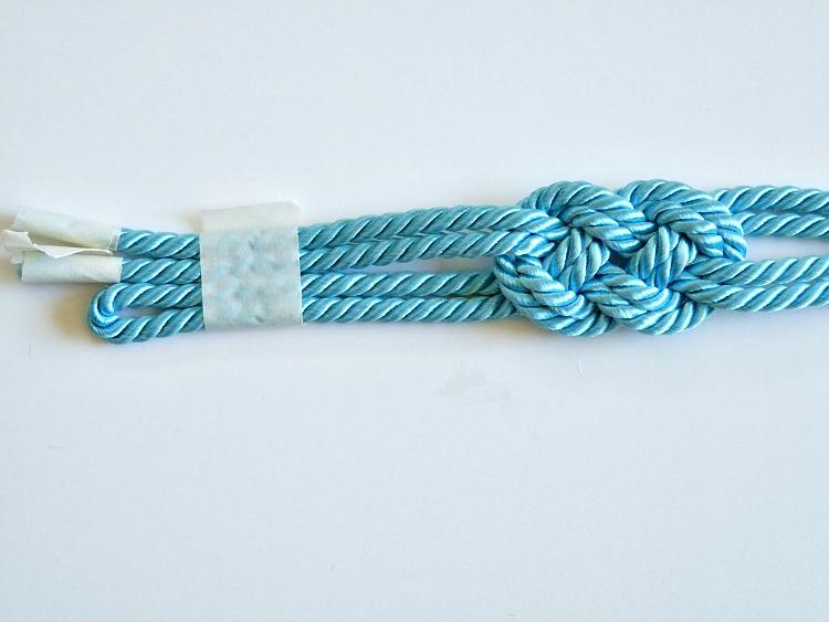 Make a knotted cord bracelet
