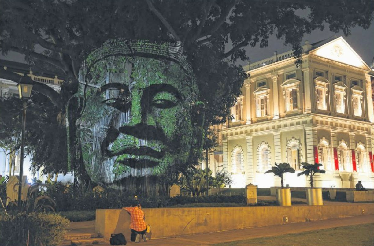 Work by French artist-photographer Clement Briend, called Divine Trees, sees images of Asian deities projected onto the trees outside the National Museum of Singapore, forming haunting, 3D-like images against the night sky.