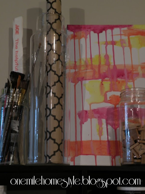Clear jars for organizing paint brushes
